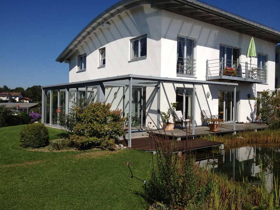Terrasse mit Glasüberdachung und Wintergarten von Stefan Lutz Überdachungen