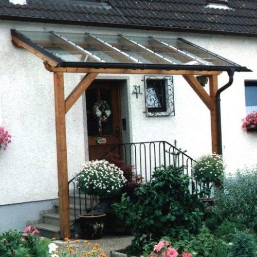 Vordach mit Holzbalken und Glasdach von Stefan Lutz Überdachungen