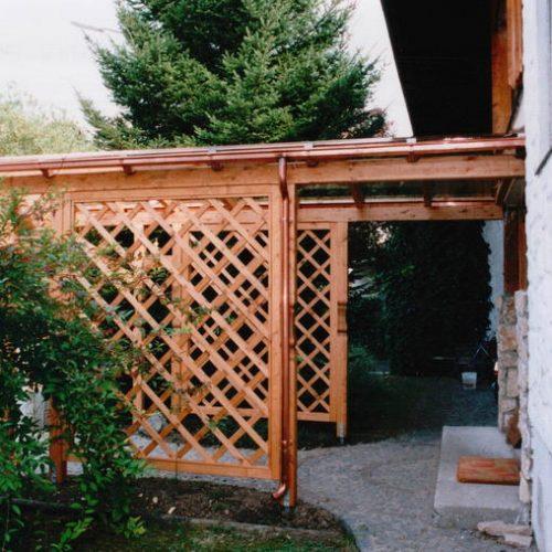 großes Vordach mit Holzverkleidung von Stefan Lutz Überdachungen